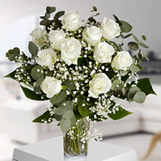 Pure 11 white roses with delivery in Ukraine - local florists and couriers. 11 roses for delivery in Ukraine